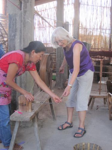 Peg attempting to spin wool in the rug weaving village of Teotitlan