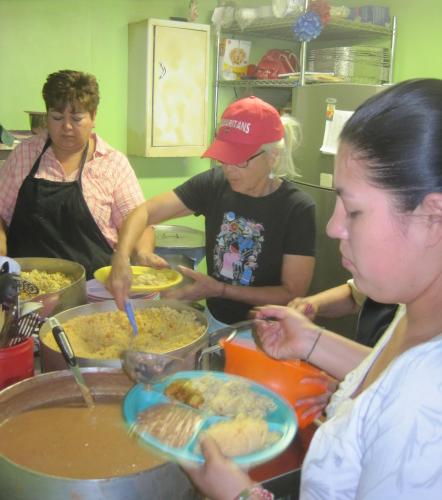Lorena, Samaritan Ruby and Mariana in the kitchen