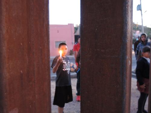A child in Mexico holds a candle for Jose