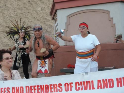 Aztec dancers drumming for justice