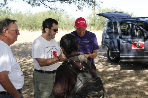 Samaritans assisting a lost migrant on a desert search