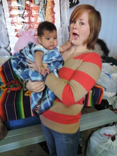 Volunteer Abby and baby Eveline