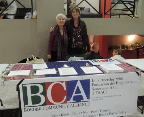 Pat Trulock and Susannah Castro pass out pamphlets for the Border Community Alliance