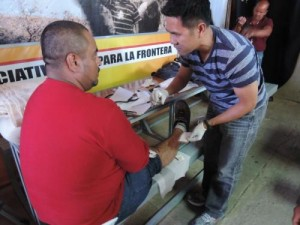 Eddie, a Jesuit novice priest, treats a wounded migrant