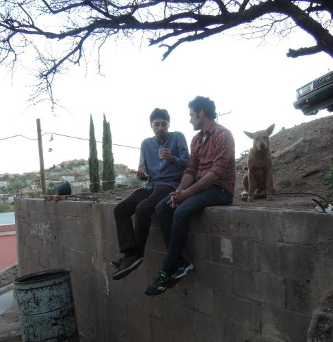Frederick and Charles share a space with a Nogales dog