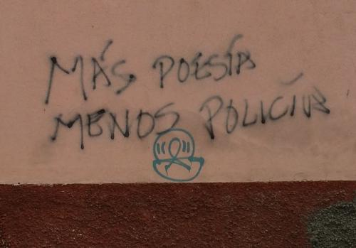 """More poetry, less police""--graffiti in Guatemala City"
